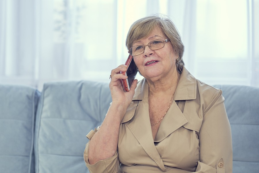bigstock-Old-Lady-Talking-On-Mobile-Pho-344859505